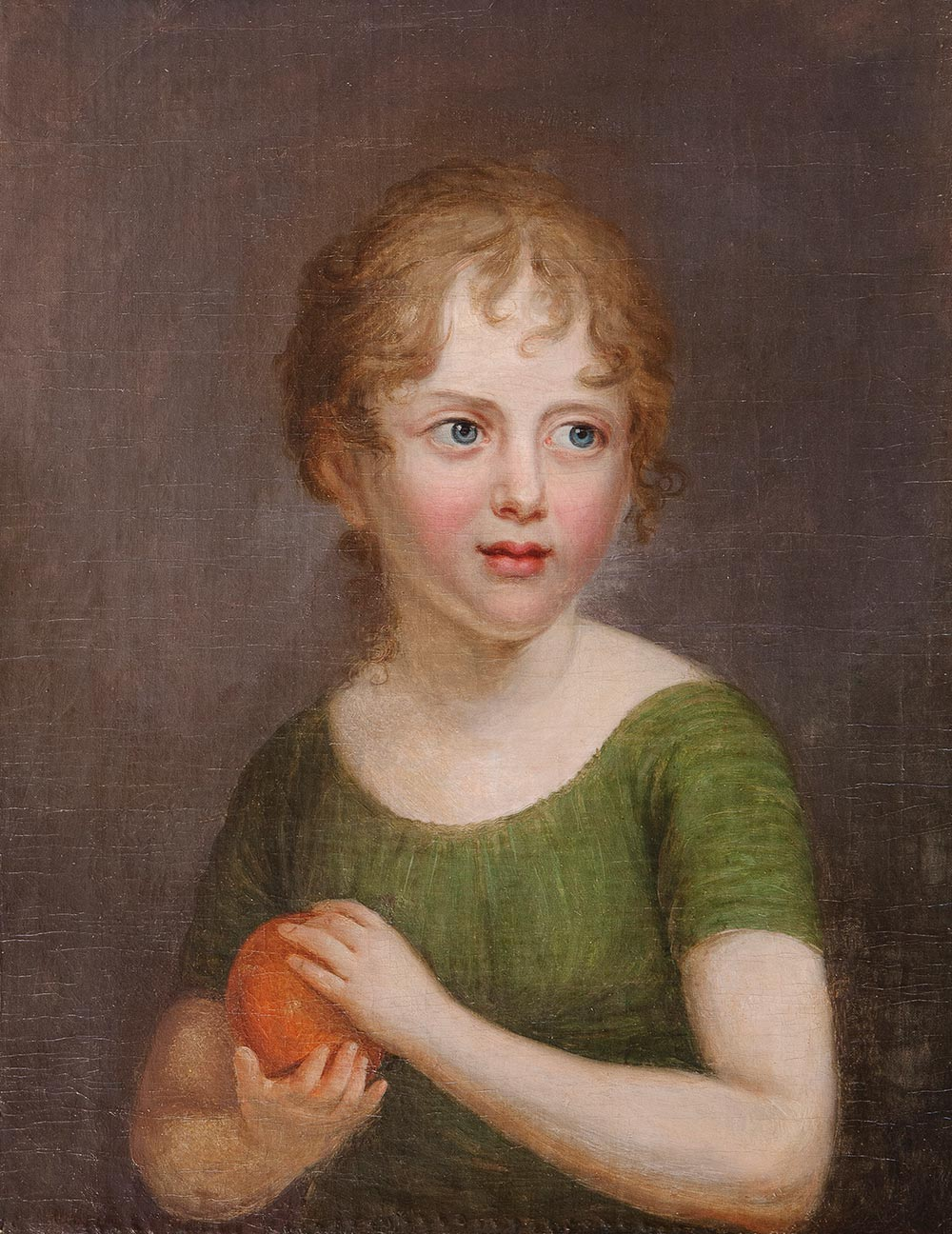 Portrait of a girl with an orange.