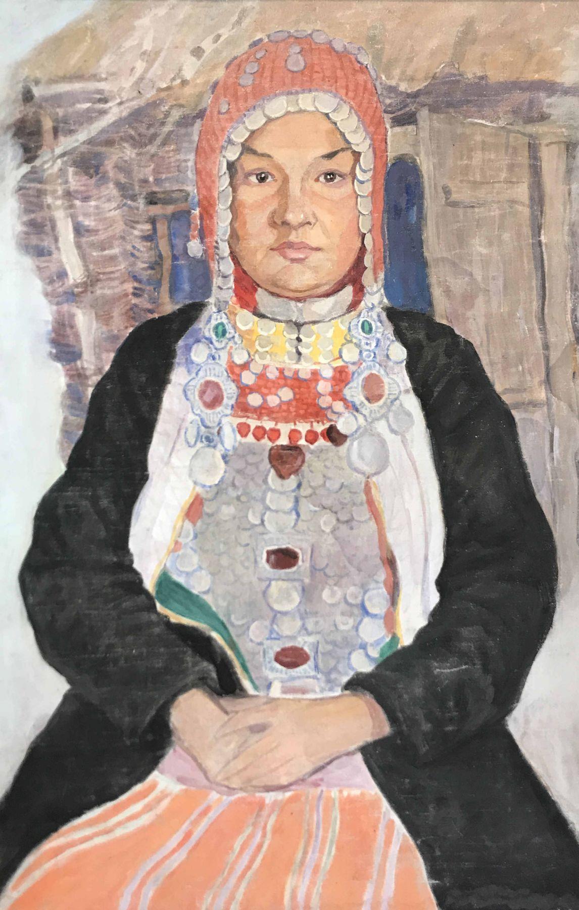 Портрет женщины в национальном костюме.