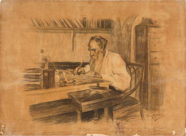 Лев Толстой за столом.