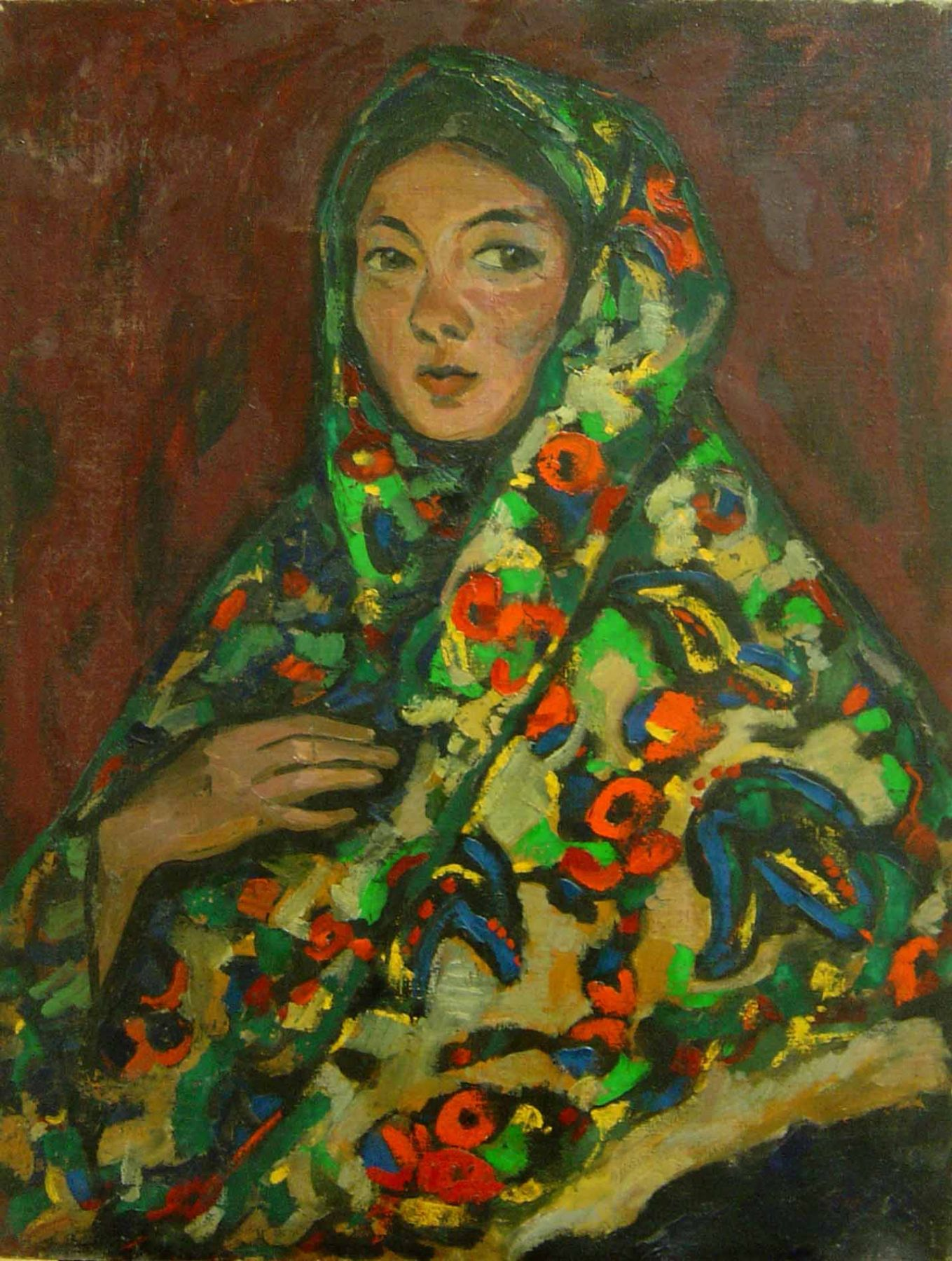 A woman in a kerchief with bright flower pattern.