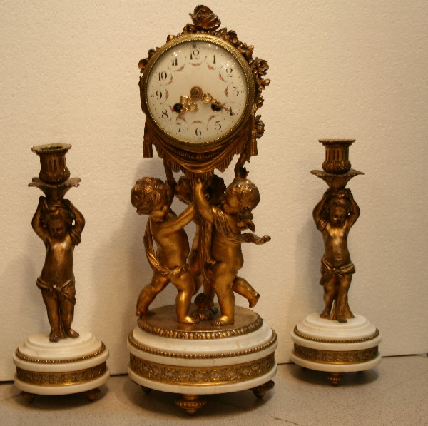 The clock and two candlesticks